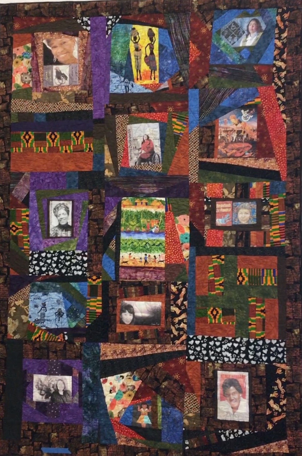 Colorful large quilt showing 8 disabled women of color: Alana Wallace, choreographer; Kathy Martinez, US Ass't Secretary Dept of Labor; Congresswoman Tammy Duckworth; writers Audre Lorde, Gloria Anzaldua, Amy Tan; Cherokee Chief Wilma Mankiller; former Congresswoman Barbara Jordan