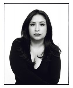 Photograph of Dior Vargas, a Latinx, with long dark hair and a black shirt